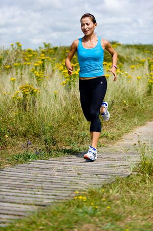 A young woman running in the countryside
