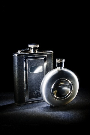 two flasks on a black background Stock Photo