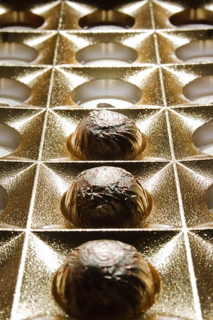 abstract background of three chocolates in a box Stock Photo
