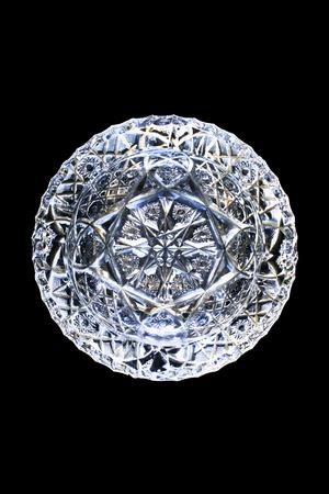 blank crystal ashtray isolated on a black background photo