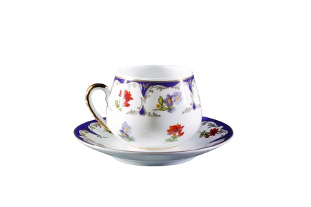 collectible porcelain cup, isolated on white background photo