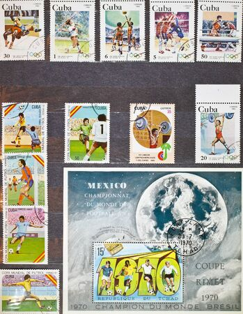 Album page with stamps on sports topics