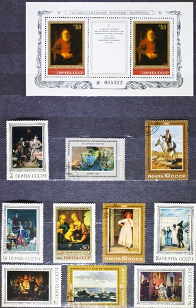 Album page with stamps depicting the work great painters photo