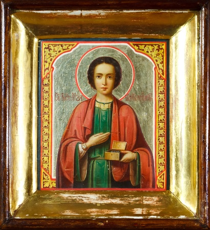 old icon of St. Panteleimon in a gold frame Stock Photo - 11481864