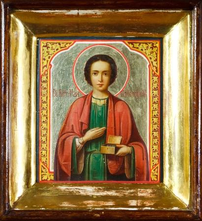 panteleimon: old icon of St. Panteleimon in a gold frame