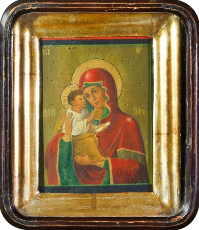Old Slavonic icon of the Virgin Mary in a gilded wooden frame photo