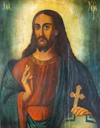 그의 손에 기독교 십자가와 예수 그리스도의 러시아어 아이콘 스톡 사진