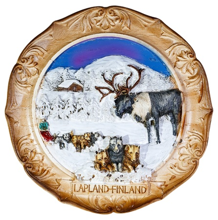 souvenir plate depicting the Lapland - Finland, isolated on white background photo