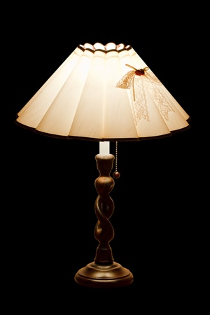 classic table lamp with lights on, isolated on a black background Stock Photo