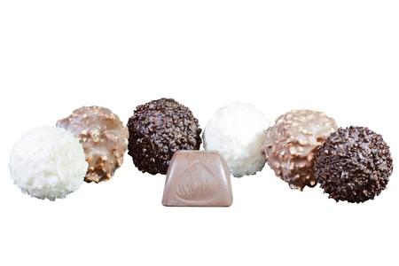 luxury chocolates in white, black and milk chocolate, isolated on white background photo