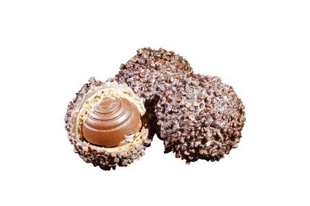 three luxury chocolates isolated on white background photo