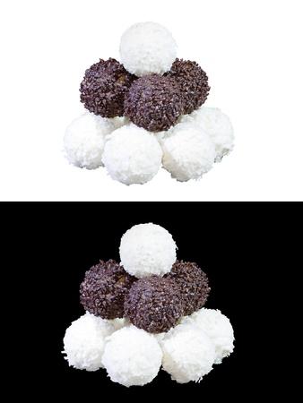 set of luxury chocolates in white, black and milk chocolate, isolated on white and black background photo
