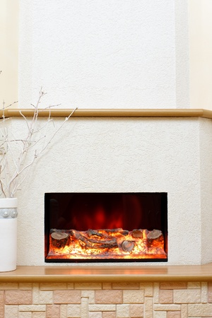 Electric fireplace in the interior of the scenery photo