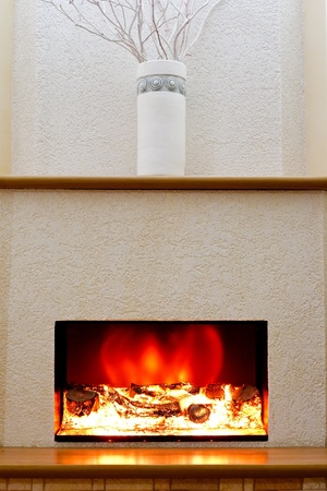 stone fireplace: Electric fireplace in the interior of the scenery