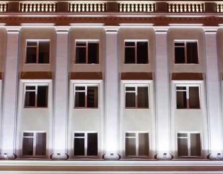 old building facades: facade of an office building at night