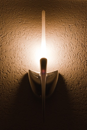 sconce: lighted wall lamp (sconce) in the interior Stock Photo