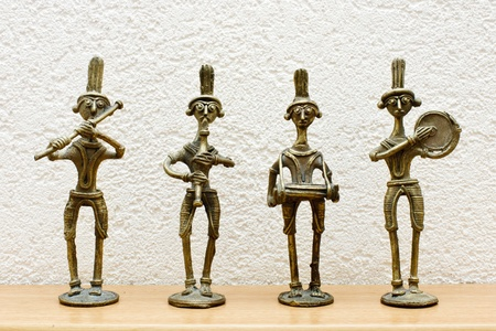 four African statues against the wall Stock Photo - 11754858