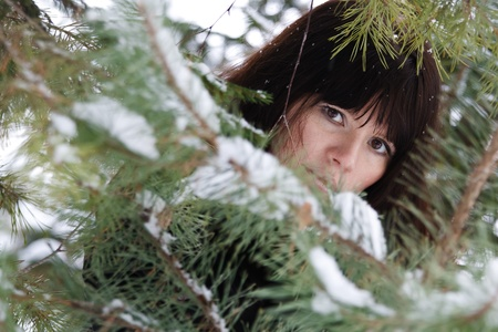 non urban 1: closeup portrait of a young girl on the background of the winter forest Stock Photo