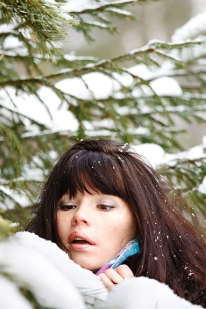 closeup portrait of a young girl on the background of the winter forest photo