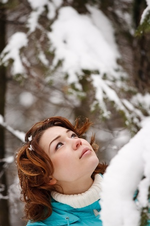 closeup portrait of a young girl on the background of the winter forest Stock Photo