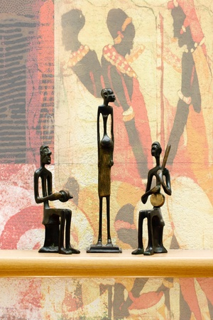 three African statues against the wall Stock Photo - 12286052