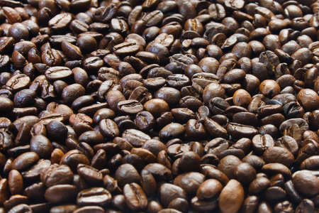 background of coffee grains at an angle of 45 degrees Stock Photo