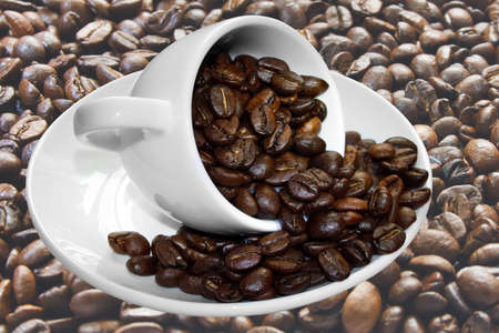 cup and coffee beans on the background of the grains photo