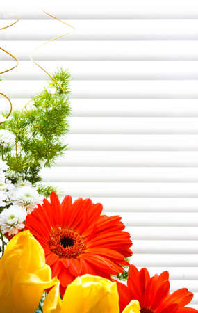 bouquet of tulips, gerberas, greenery, wild flowers, on a striped background