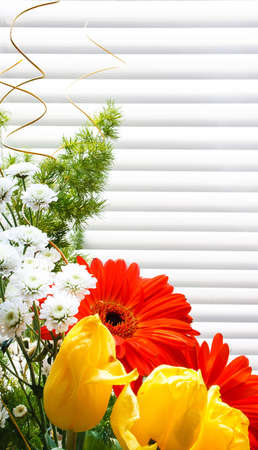 bouquet of tulips, gerberas, greenery, wild flowers, on a striped background Stock Photo - 12746195