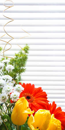 bouquet of tulips, gerberas, greenery, wild flowers, on a striped background Stock Photo - 12746192