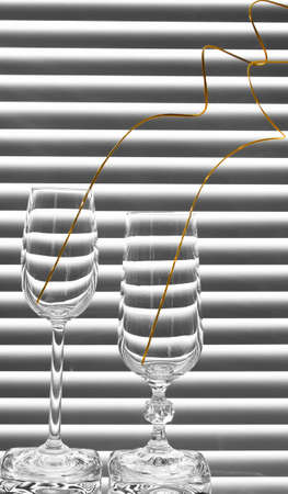 two glasses with spiral branches on the black and white background