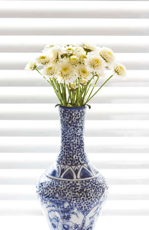 a vase of wild flowers on the black and white background Stock Photo