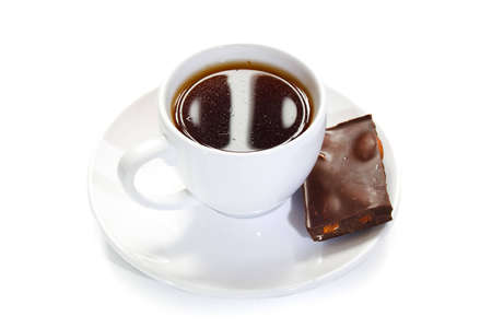 cup of coffee with a piece of chocolate on a white background Stock Photo