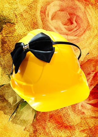 construction helmet and black Hair band with a bow on a colored background Stock Photo