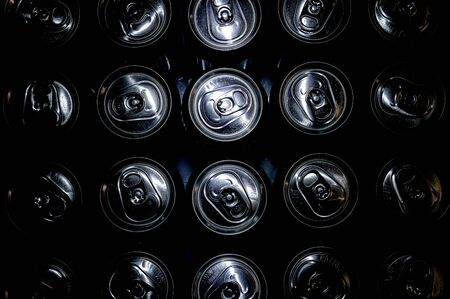 Low lite image of the top of beverage cans Banco de Imagens