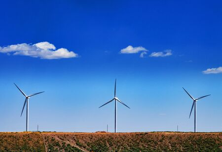 Wind turbines in country in front of nice clouds