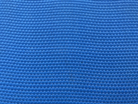blue polyester mesh of sunbed as background