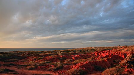 Barn Hill red cliffs near Broome at sunset on a cloudy day.