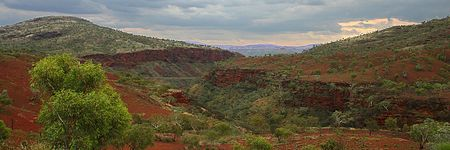 Panorama of Munjina Gorge late in the afternoon on a stormy day Stock Photo