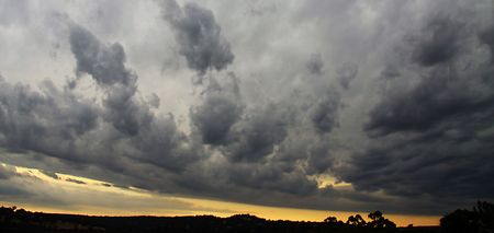 Dramatic clouds at sunset following severe hail storm