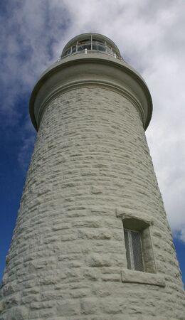 Historical and imposing vertical view of a stone lighthouse at Bathurst Point, Rotnest Island, Western Australia