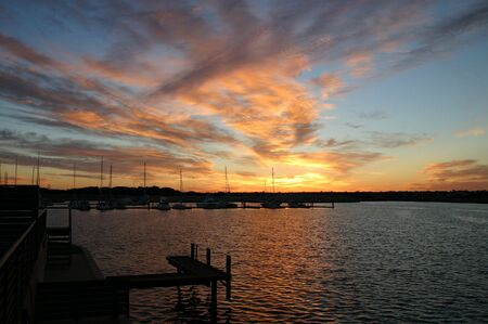 Port Geographe Marina at sunrise, with yatch masts silhouetted against sky