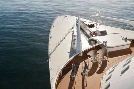Wide angle view looking forward from bridge wing over bow of large cruise ship Stock Photo
