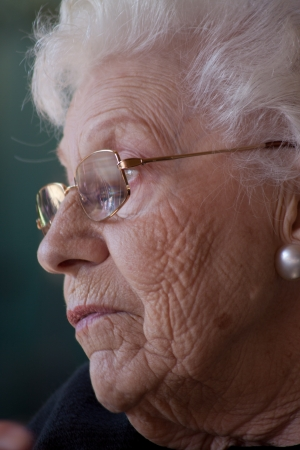 Facial view of old lady with interestingly wrinkled face and pure white hair