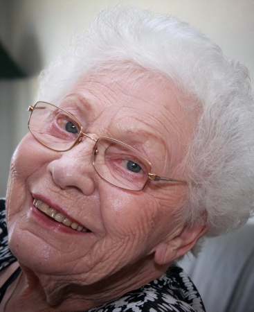 Facial shot of a grandmother with interestingly wrinkled face and pure white hair