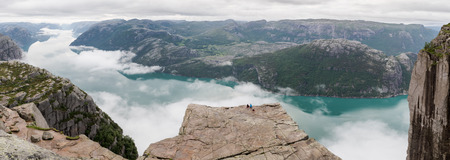 Couple enjoying view from Preikestolen, Pulpit Rock, Norway Stock Photo
