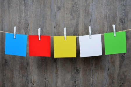 forgetfulness: 5 colored post it hanging on a clothesline