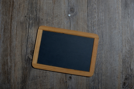 forgetfulness: little schoolboy slate hanging on a wooden wall