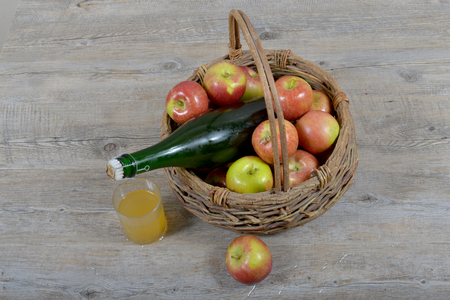 Apple basket and bottle with a glass of Norman cider