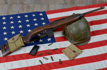 carbine: carbine usm1 with some bullets and military helmet